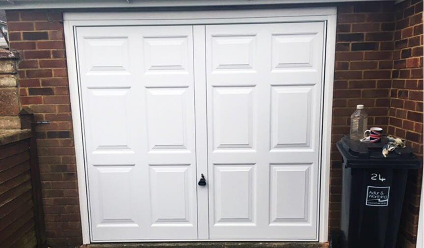 man lifting garage door