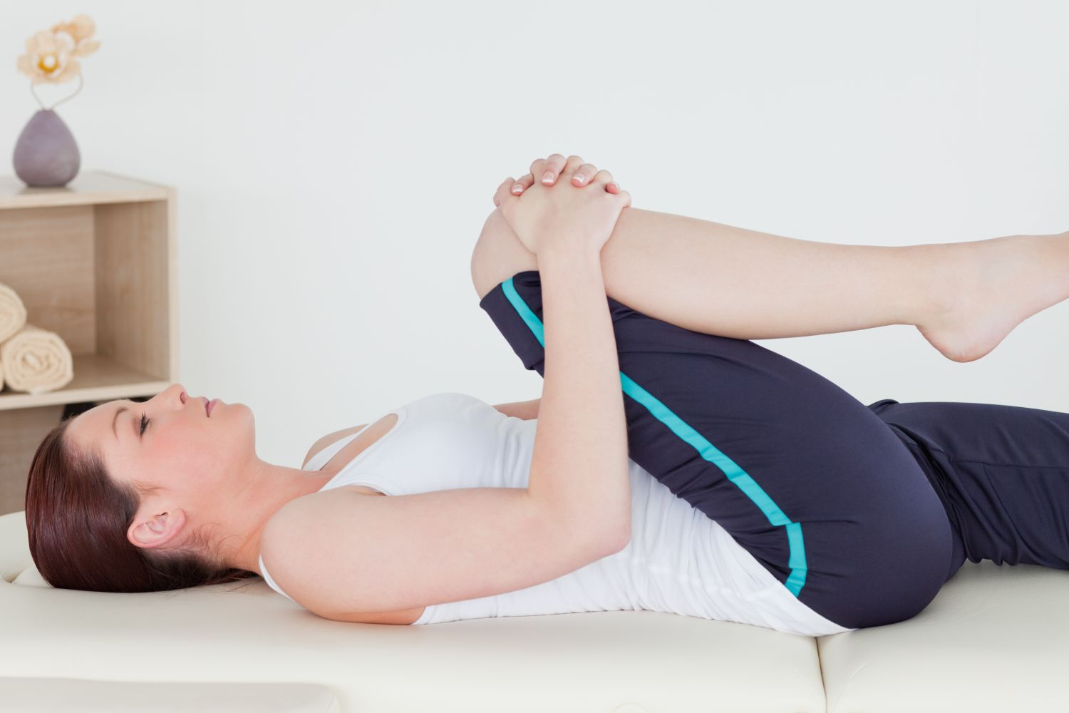 Woman stretching at chiropractic center in Anchorage, AK