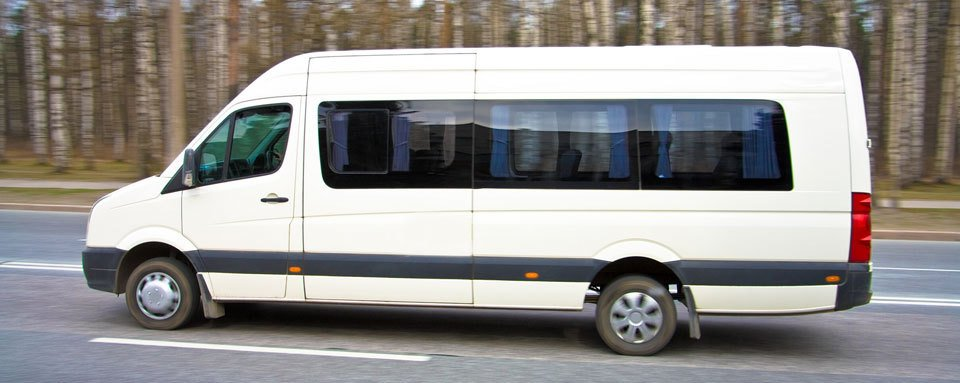 A white mini bus