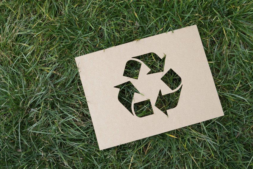 recycling icon on grass