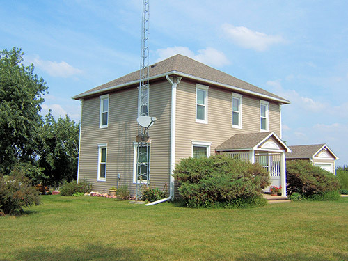 Side view of the house after siding got repaired by teh contractor in Table Rock, NE