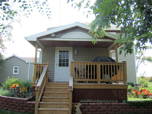 Front view of the house after siding got repaired by teh contractor in Table Rock, NE