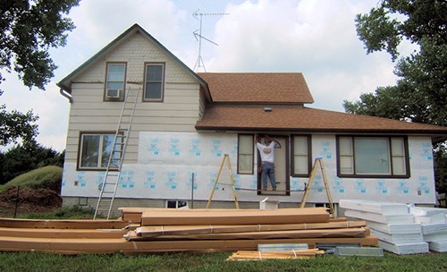 Installing siding on the exterior of the house in Table Rock, NE