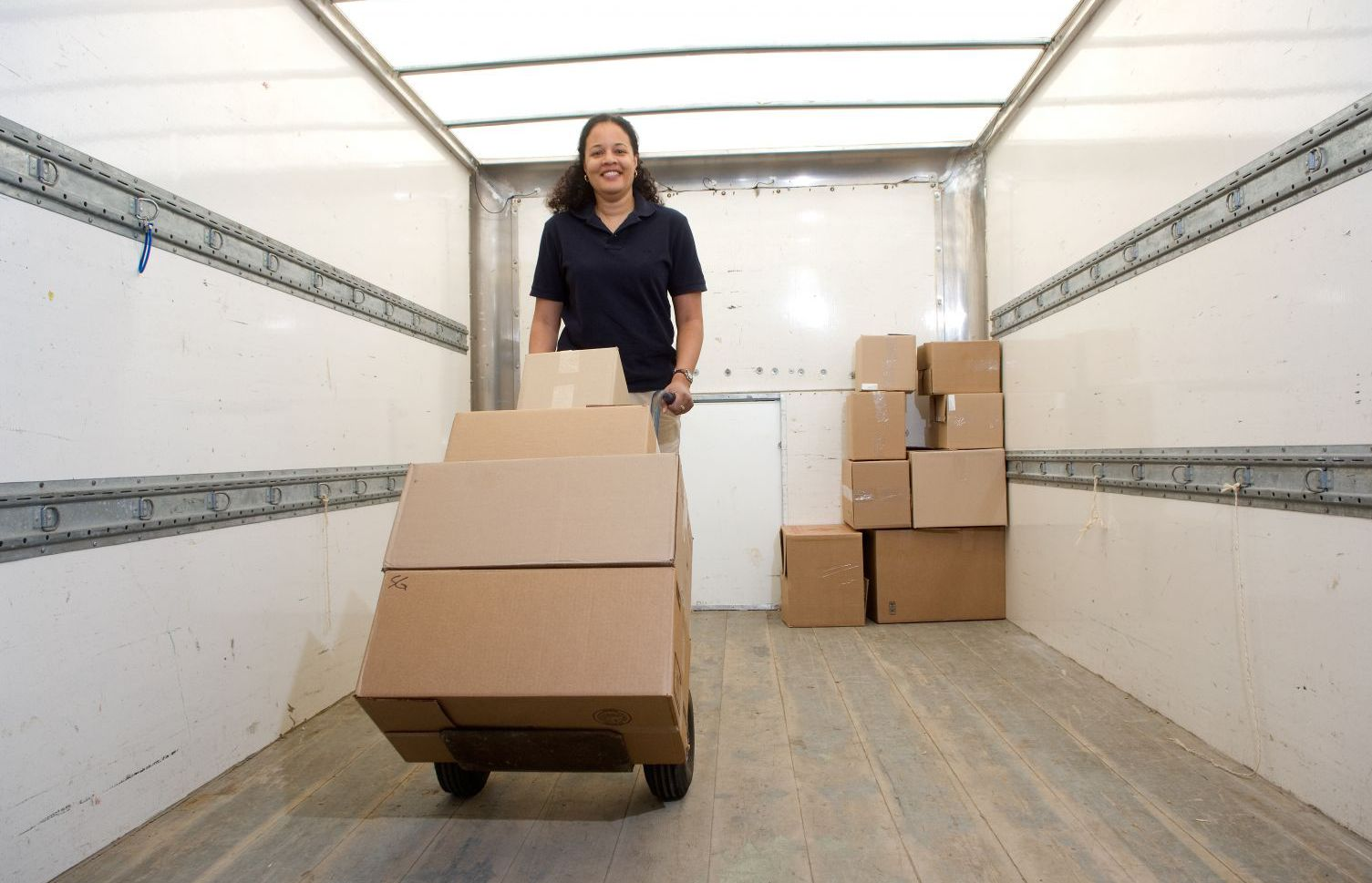 Woman moving boxes at one of our safe storage units in Columbia Falls, MT