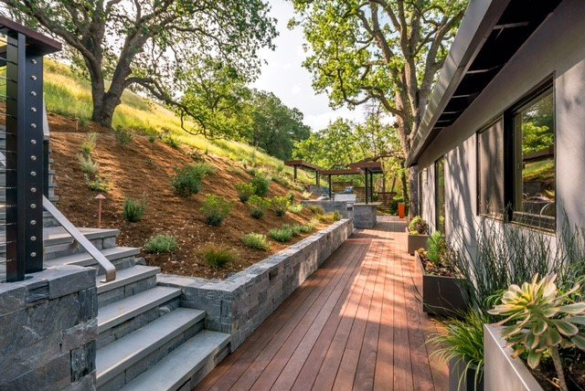 stone retaining wall and steps with wood deck