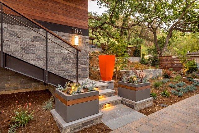 Lit stone steps, retaining wall, planters