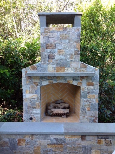 stone and brick outdoor fireplace