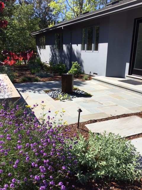 stone path and patio with landscaping