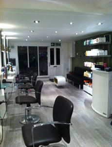 salon interior with grey wood effect flooring