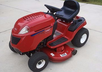 Service riding lawn mowers