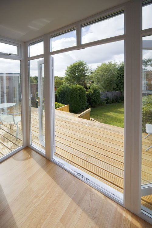 wooden deck seen through a window - garden view