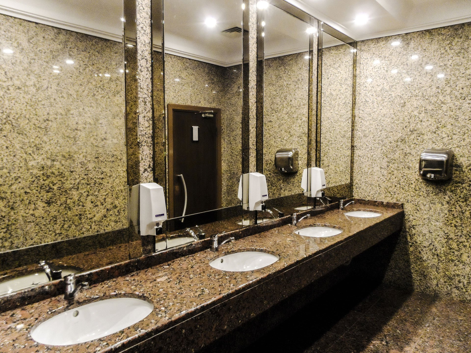 Bathroom with granite countertops - Architectural Surfaces For Commercial Applications