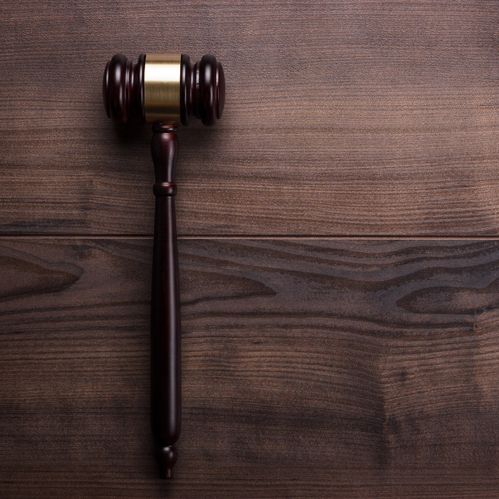 A gavel on a wooden desk
