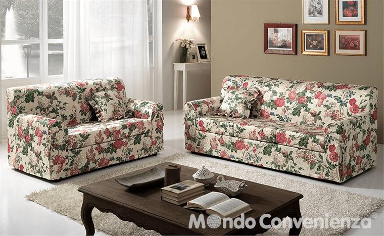 vista interna di una sala con divani, libri sul tavolo, tappeto e arredo di casa