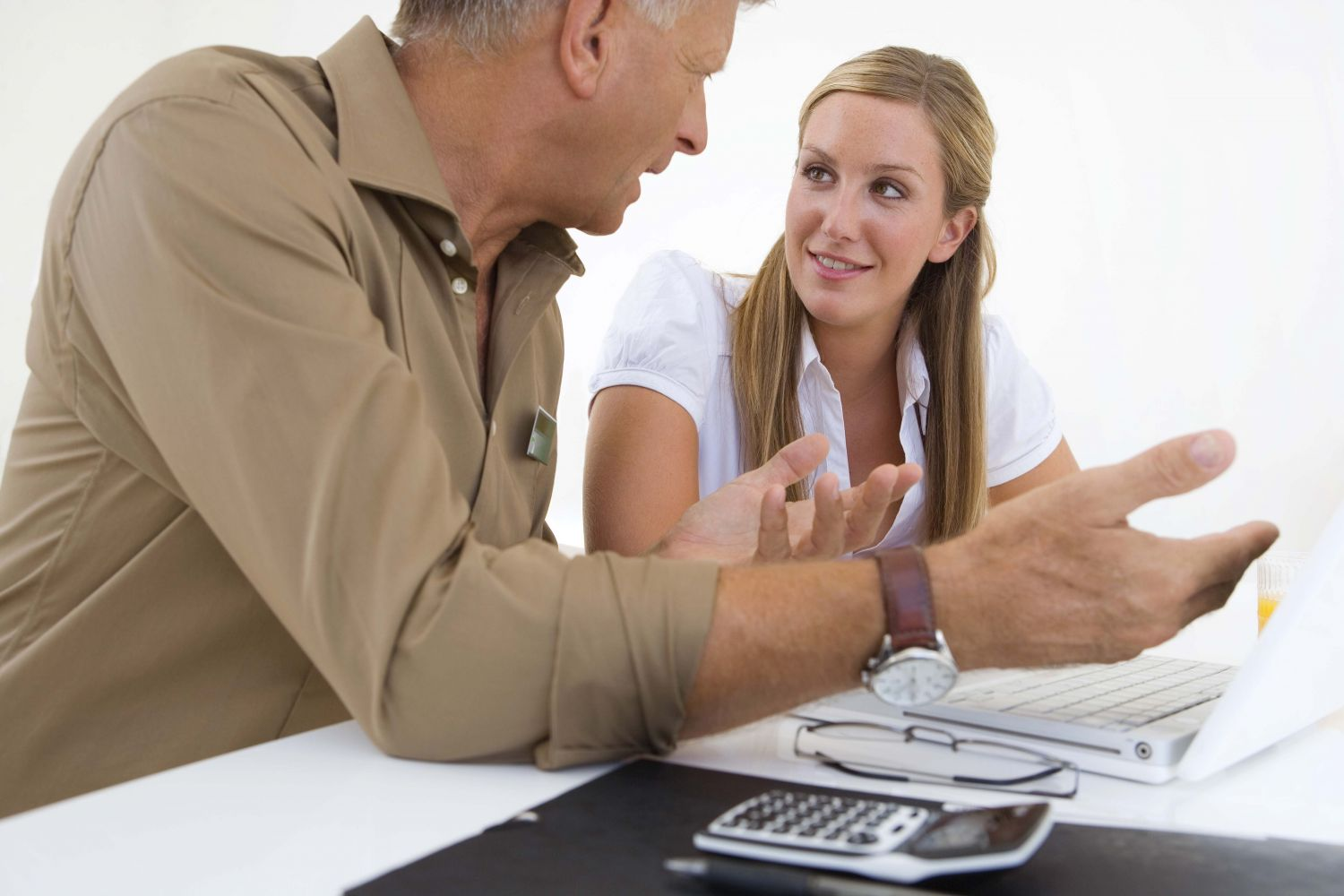 Man helping woman with accountancy services in Archdale, NC
