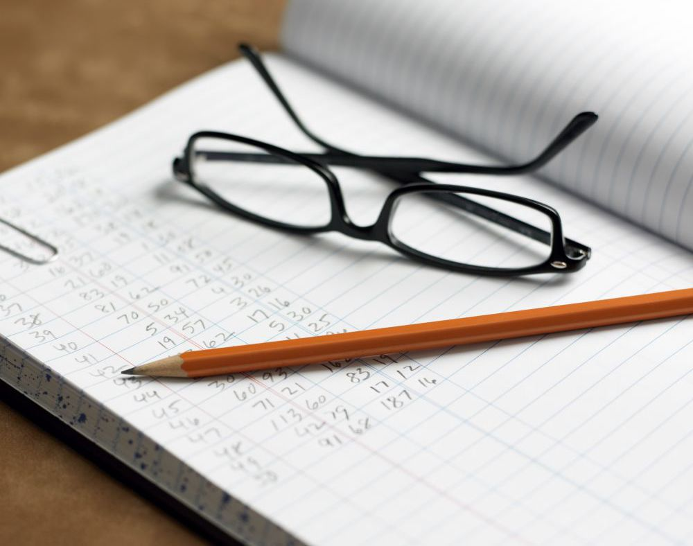 Glasses and pen resting on accounting book Archdale, NC