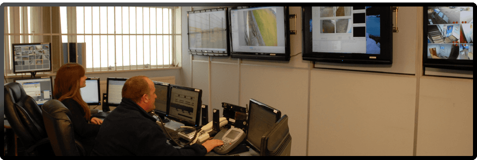 Security team monitoring CCTV on screen