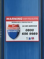 Alarm box with 1st Reaction Security Limited logo