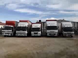 Five road transport trucks lined up