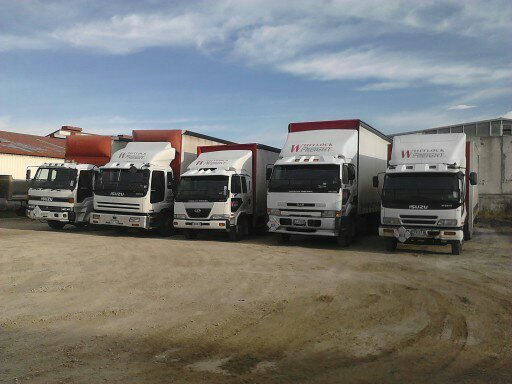 A variety of different sized freight trucks