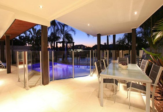 aus design fencing and balustrade and champagne glass handrails and fencing night view of dining table next to swimming pool  with glass fence