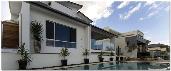 aus design fencing and balustrade and champagne glass handrails and fencing house with frameless glass