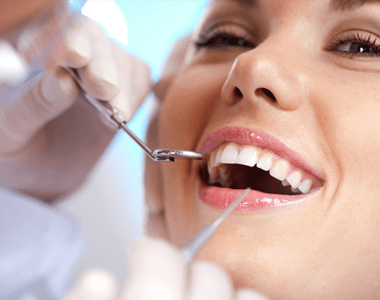 A lady having her teeth examined
