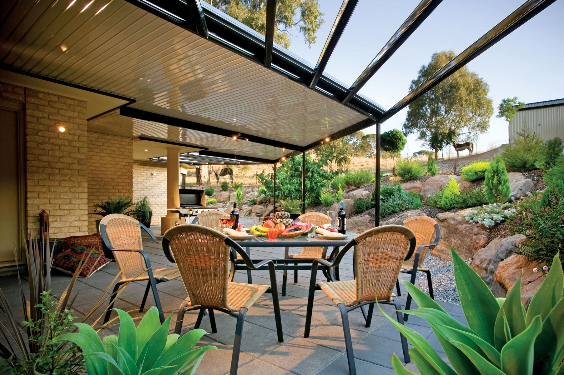 Opening Sunroofs in the beautiful garden by the best Patio Builders in Kingscliff