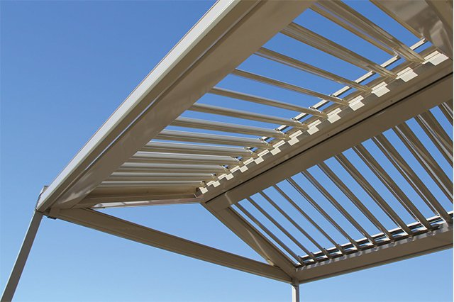 The bright daysky under the opening sunroof proudly made by patio builders in Tweed Heads