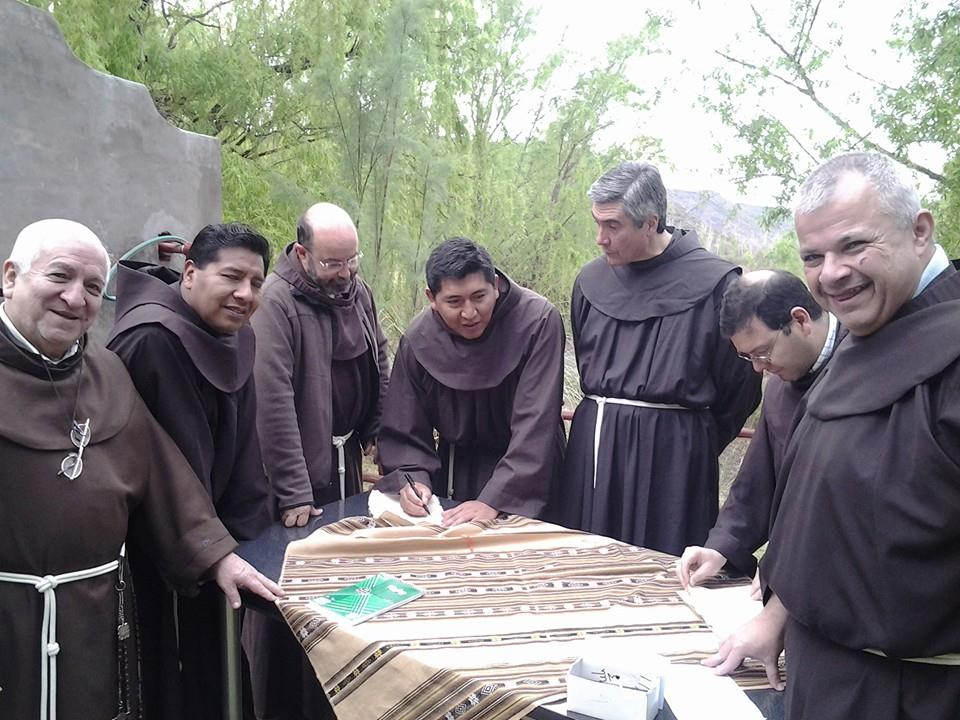 Argentinian Friars pose in an outdoor scene around a table