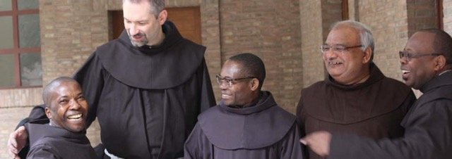 Five missionary Friars from various nations pose for the camera