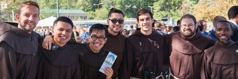 Young smiling American Friars pose for the camera
