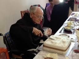 Ignatius cuts the cake