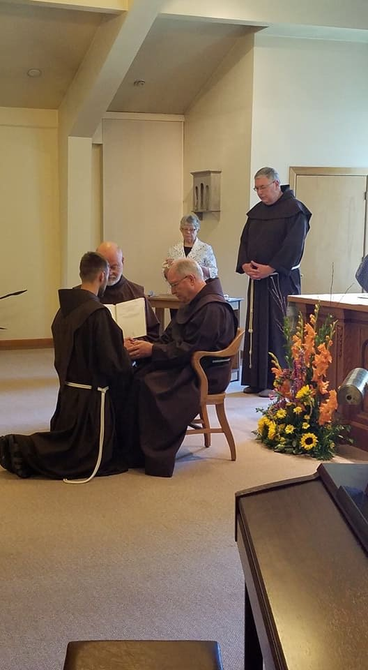 Kes kneels before Father Patrick