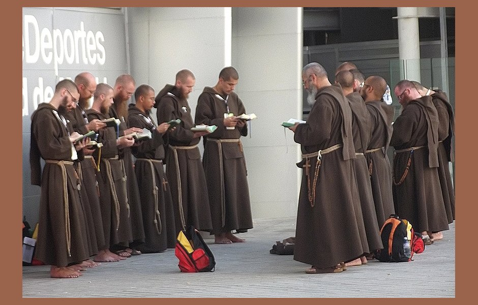 Friars gather in public to pray from their prayerbooks