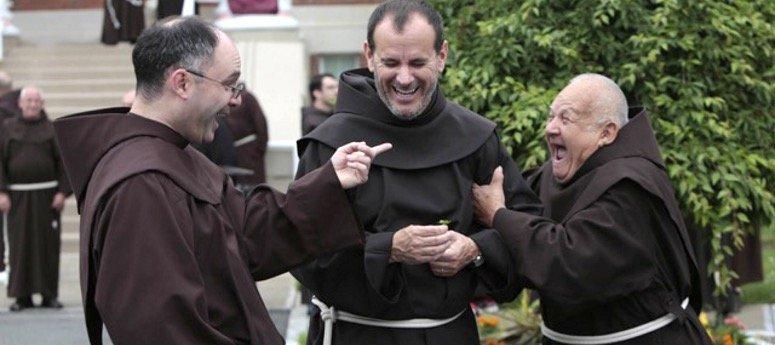 Three Friars in a lighthearted moment enjoying each other's company