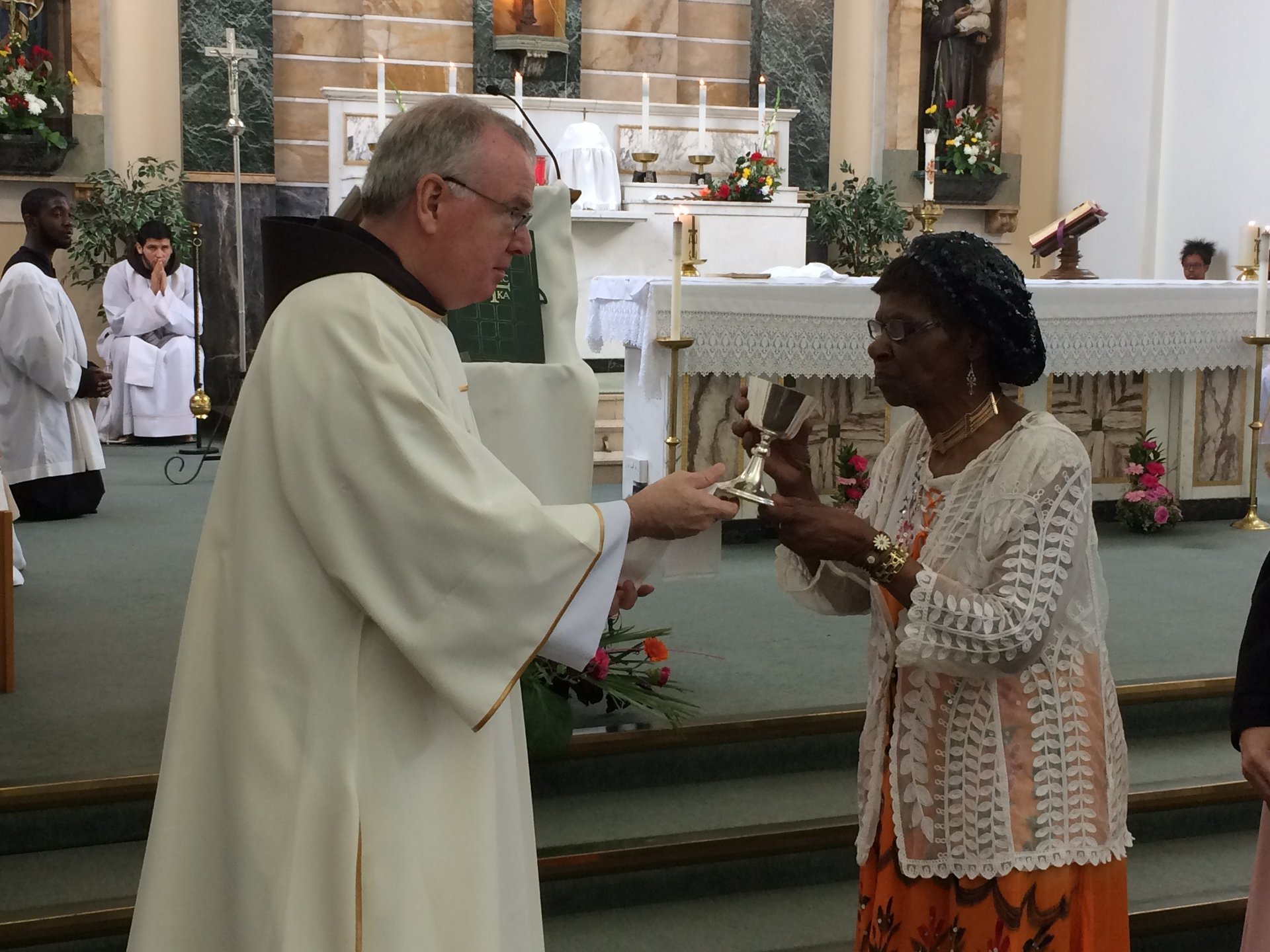 Deacon Michael administering holy communion