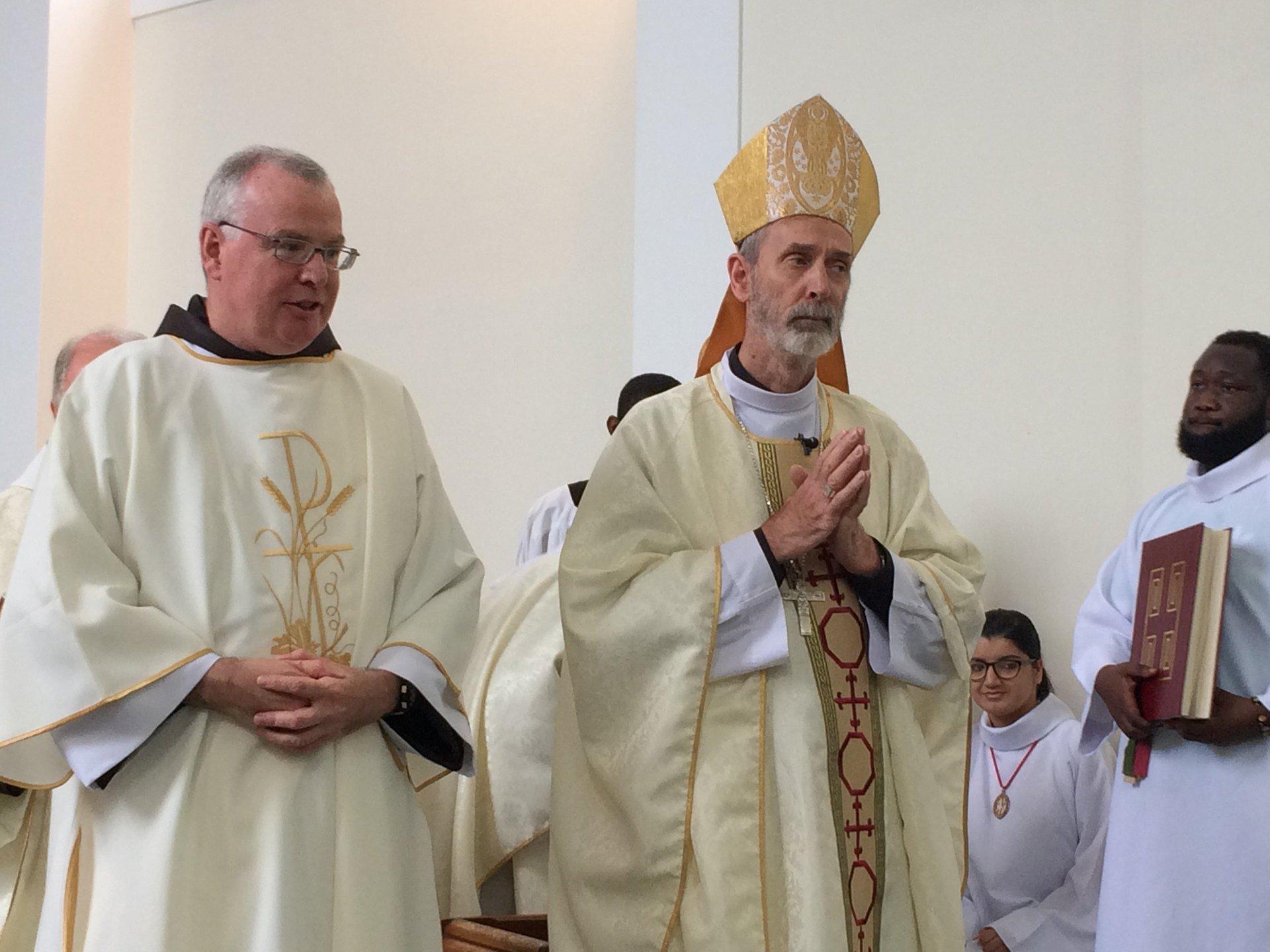 Deacon Michael stands beside Bishop