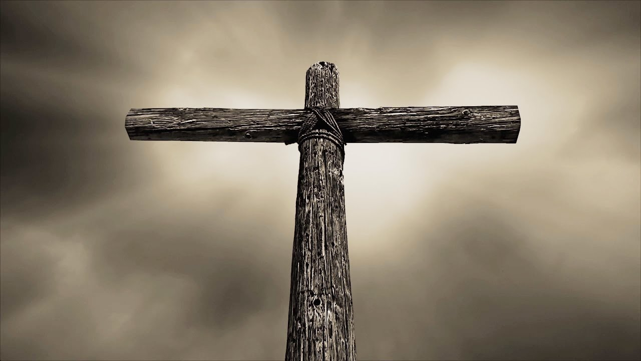 And image of a wooden cross pointing to the sky