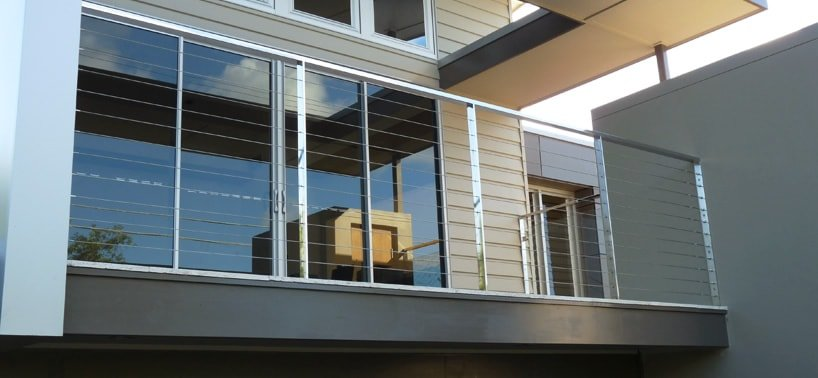 Stainless steel balcony fencing with intermediate posts