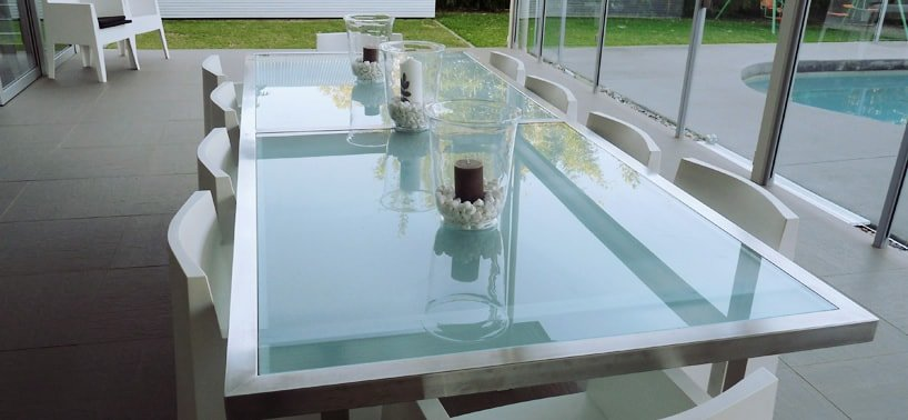 Stainless steel table with toughened green glass