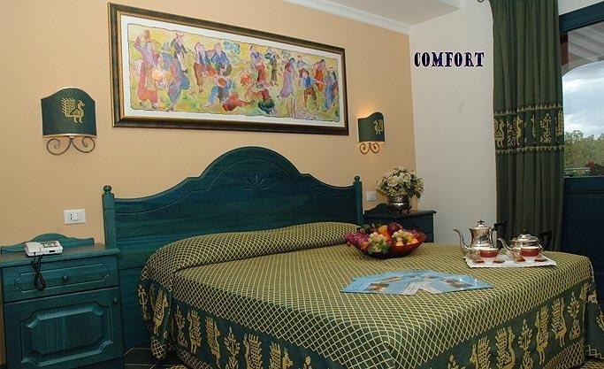 Camera Confort Cala Ginepro giallo verde