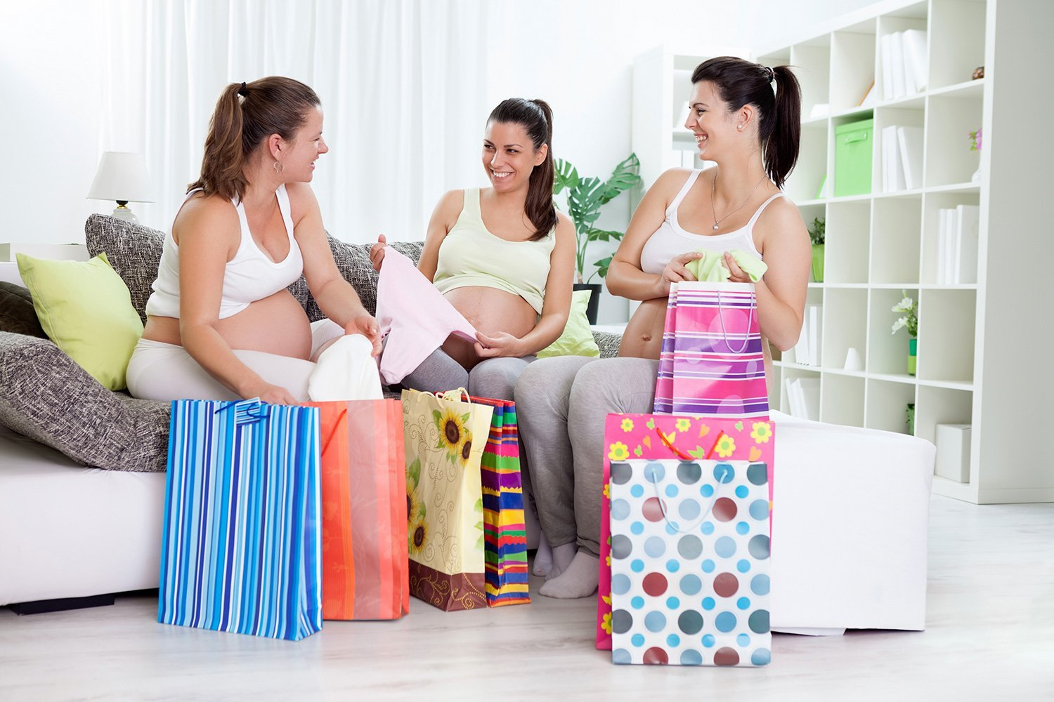 Happiness pregnant women with their shopping bags at home