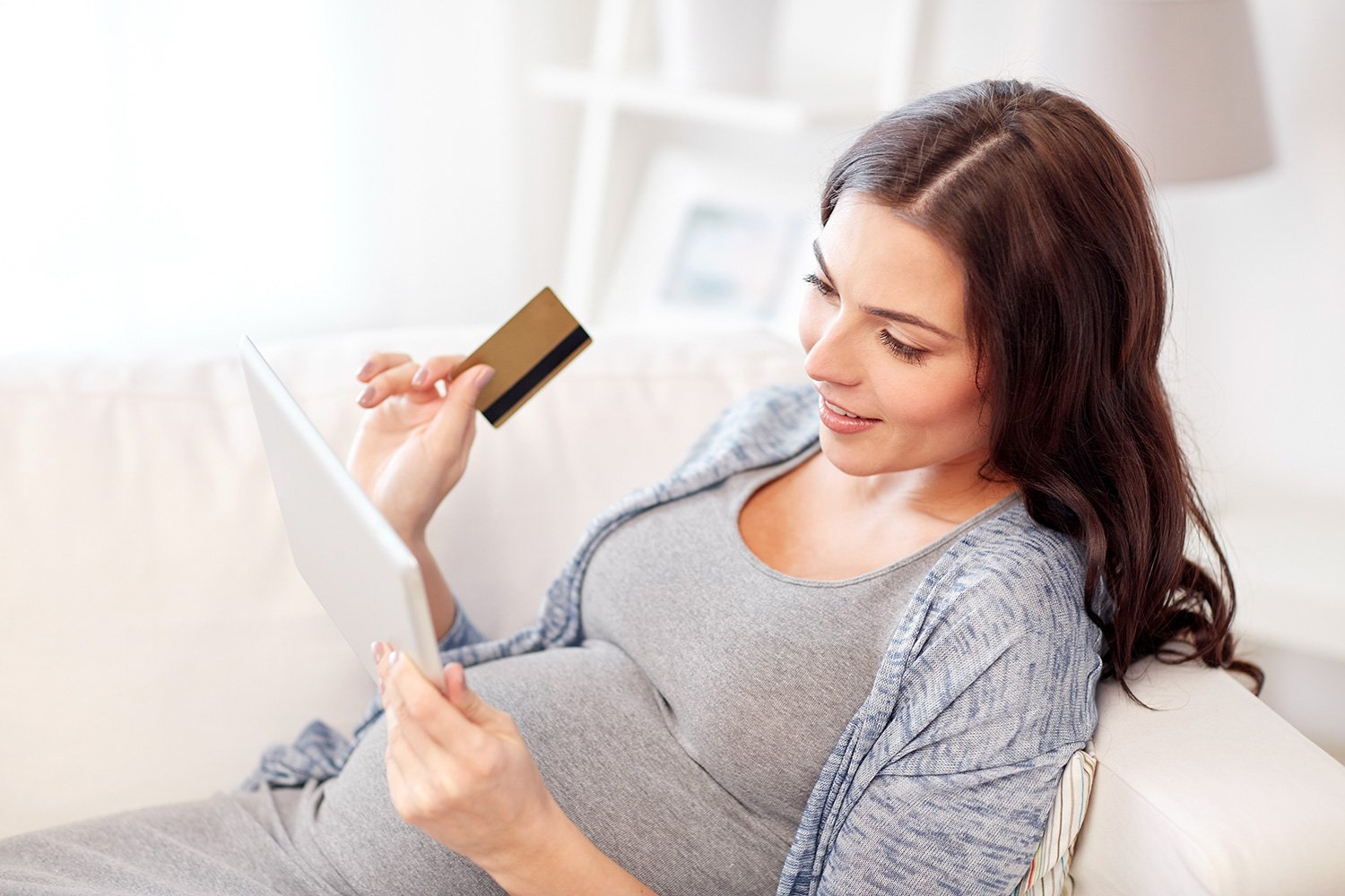 pregnancy, online shopping, technology and people concept - happy pregnant woman with tablet pc computer and credit card at home