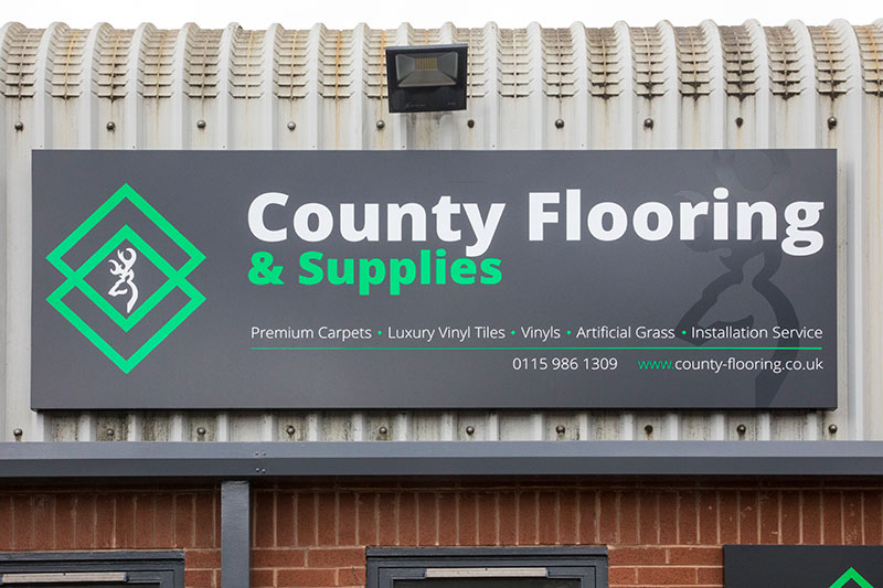 County flooring & supplies sign