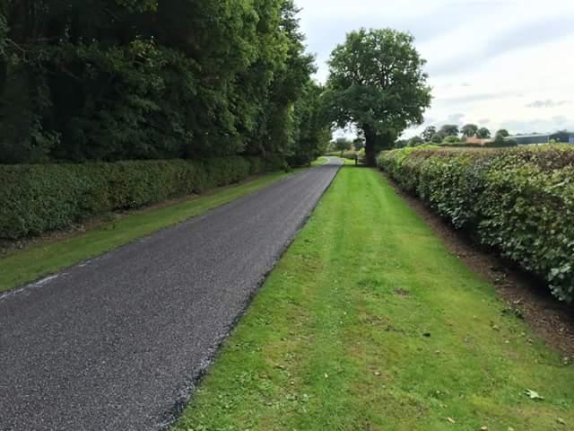 surfaced road alongside lawn