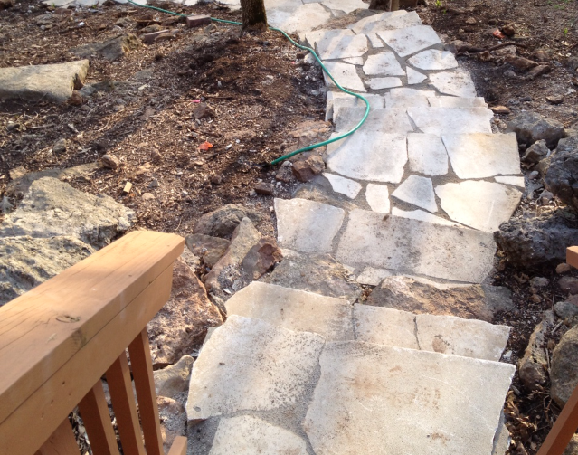 stone pathway and steps down to a lake