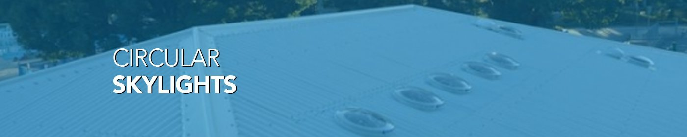 Round skylights on a roof with blue tint