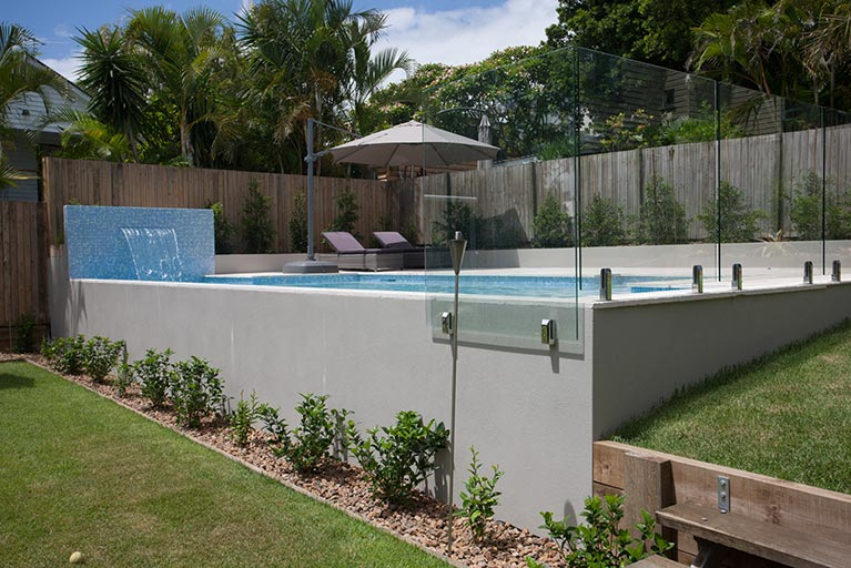 new pool with glass fencing and waterfall grange