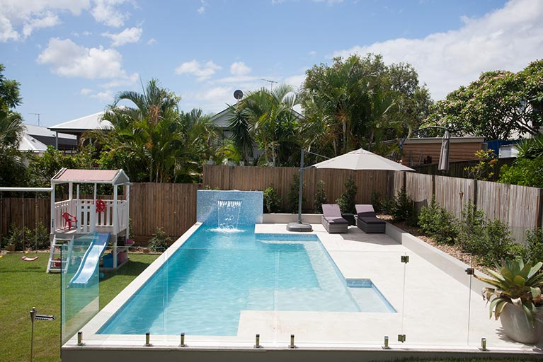 pool with lounge area and kids playground grange